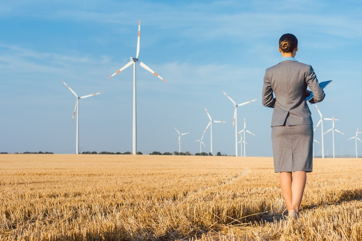Businesswoman And Wind Turbines (1)