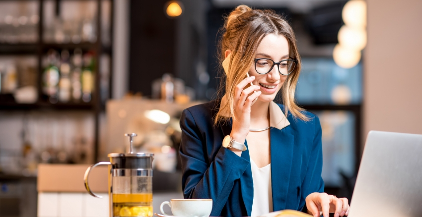 Business Woman Talking On Phone With Laptop