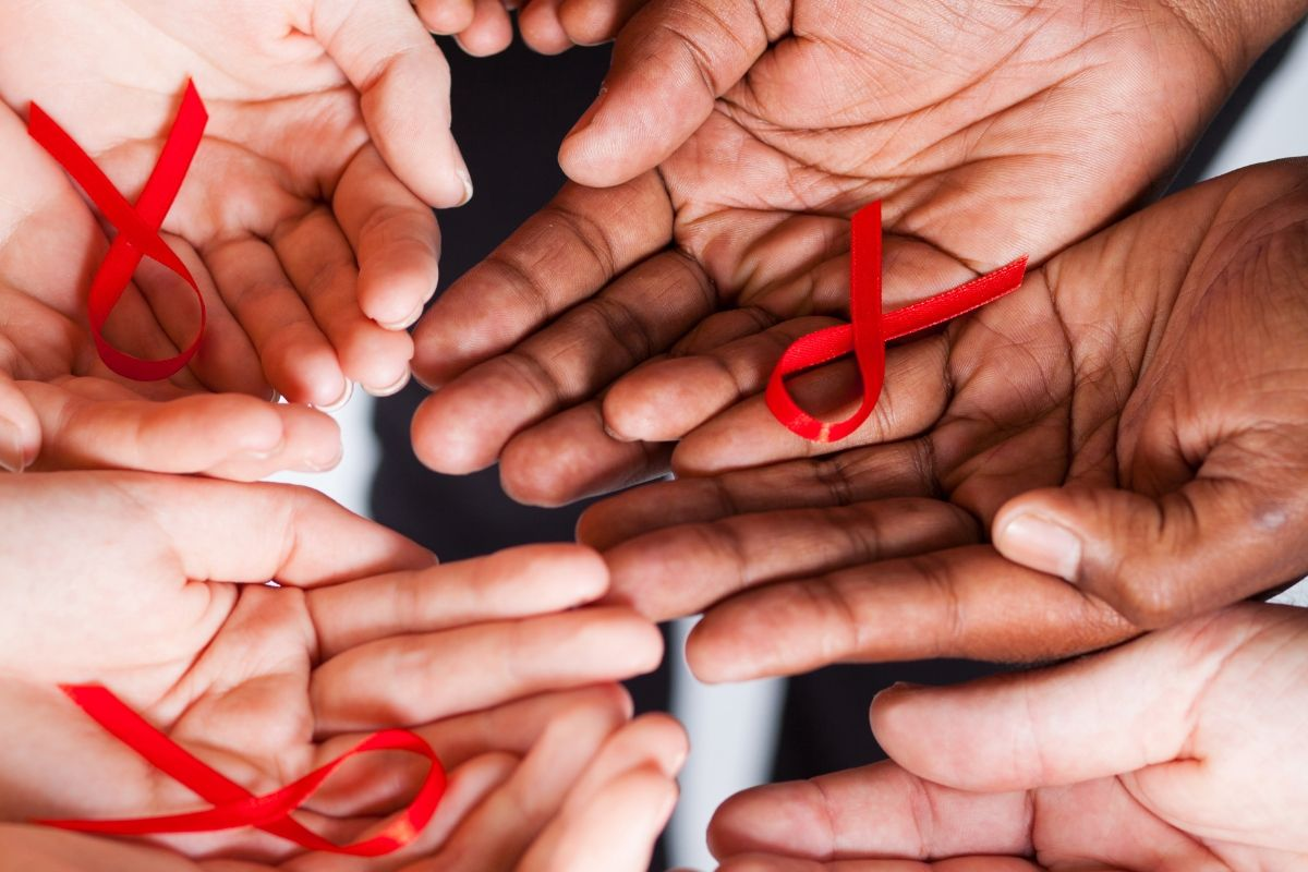 Hands With Red Ribbon Charity