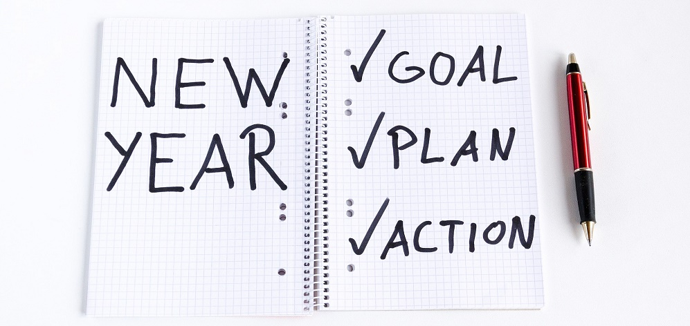 note book with new year action plan
